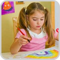 girl painting rainbow