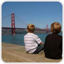 two boys looking at the Golden Gate bridgey