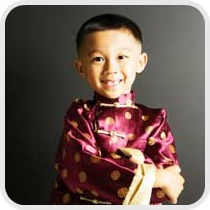 child dressed in traditional Chinese costume