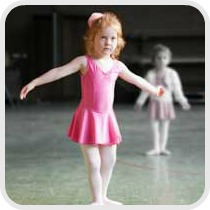 girl taking a ballet lesson