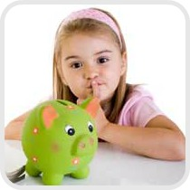 girl looking at piggy bank