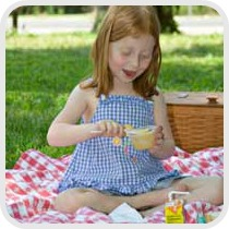girl eating a picnic lunch