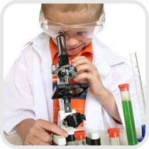 boy looking into a microscope
